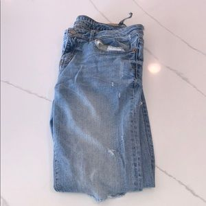 Light blue jeans with ripped on knees, butt area